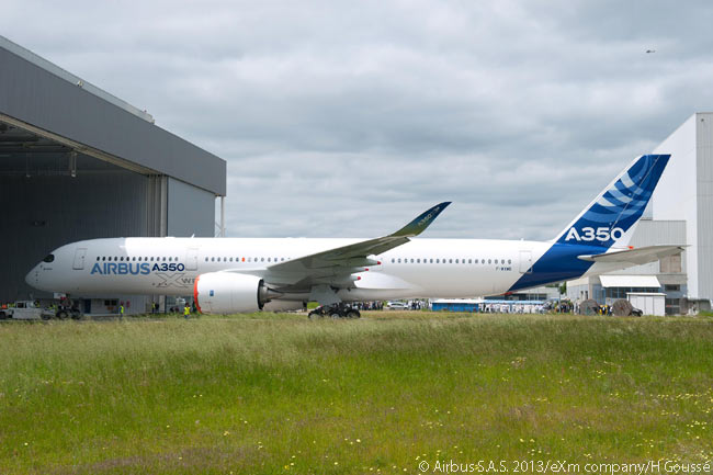 Airbus A350 XWB MSN001 wears the Airbus house livery as it emerges fully painted from the manufacturer's paint shop at its Toulouse assembly line. Note that the aircraft's Rolls-Royce Trent XWB engines do not feature the noise-reducing scalloping at the back of the nacelle which are a feature of the Rolls-Royce and General Electric engines installed on Boeing 787s